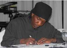 Benjy Myaz signing autographs at his album release party.